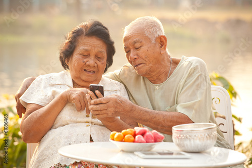 Senior couple using the mobile phone