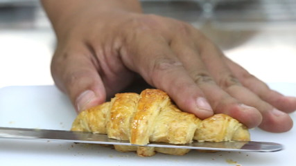 croissant cutting, kitchen background