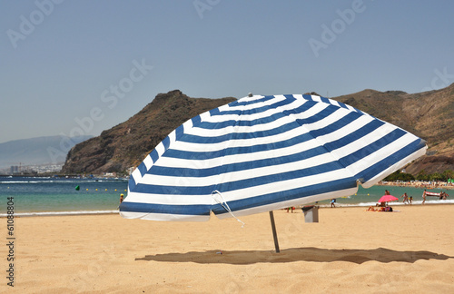 Striped umbrella on the Teresitas beach of Tenerife island. Cana
