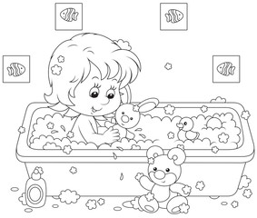 Girl bathing with toys