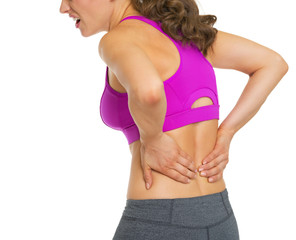 Closeup on young woman having back pain
