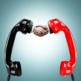 A handshake, a telephone conversation successful businessmen