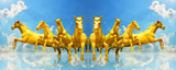 Group of golden horses running on the sky