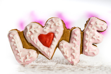 Cookies with text of love and red heart on Valentine's Day