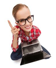 smiling teenage girl in eyeglasses with laptop