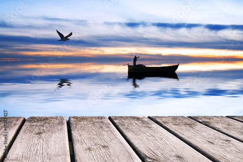 Fotobehang Een Hoekje om te Dromen pescador en bote tradicional