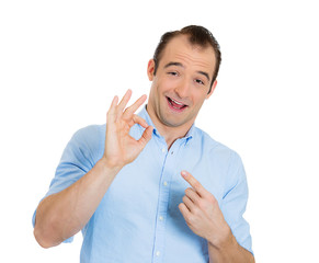 Portrait funny looking man showing ok sign on white background