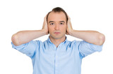 Man covering ears, hear no evil, avoiding situation, conflict