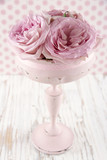 Pink roses in a wooden pastel color vase