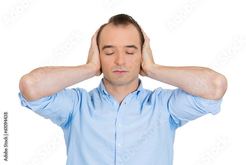 Man covering ears, closing eyes, hear, see no evil