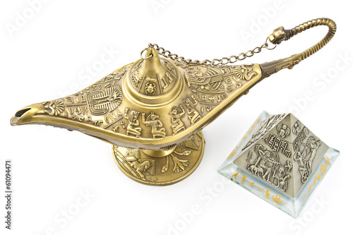 Magic genie  lamp and brass pyramid isolated on white