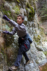 Teenager boy climbing