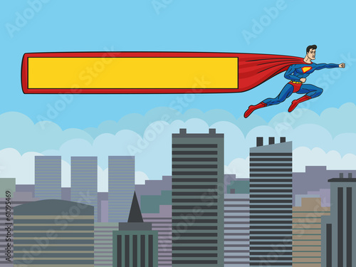 Superman with a banner over the city.