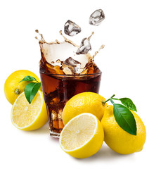 Glass of cola with ice and lemon isolated on white.