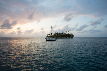 Sailing with beautiful sunset near paradise island, San Blas