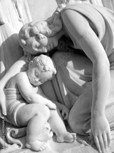 mother mourning her child - sculpture on monumental cemetery