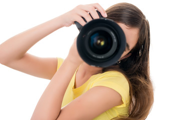 Girl using a professional camera isolated on white
