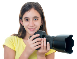 Child using a professional camera isolated on white