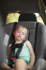 Little girl sleeping in car seat.