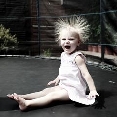 Little girl jumping in trampoline