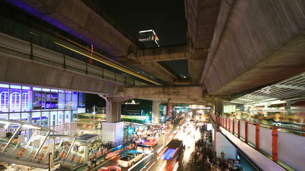 Bangkok downtown busy traffic, time lapse at night