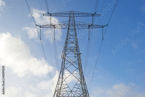 Overhead power line in a blue sky in winter