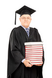 Middle aged college professor holding a stack of books
