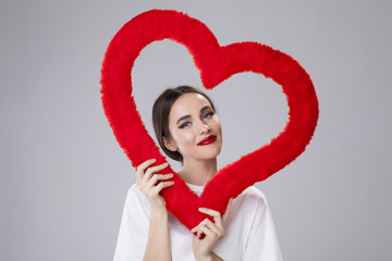 Young Woman holding a Red Fabric Heart