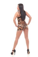 young woman in beautiful dress posing at studio