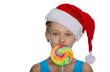 Girl with lollipop in Santa hat
