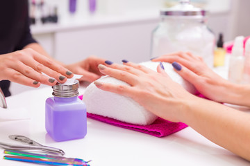 Nails saloon woman nail polish remove with tissue