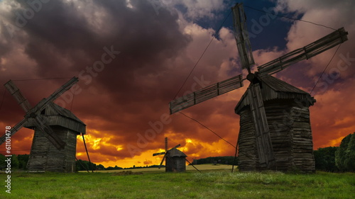 Old windmills on sky background.