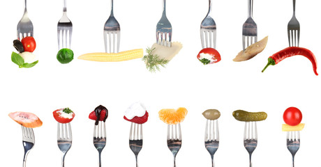 Collage of food on forks isolated on white