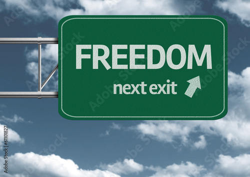 Freedom, next exit creative road sign and clouds