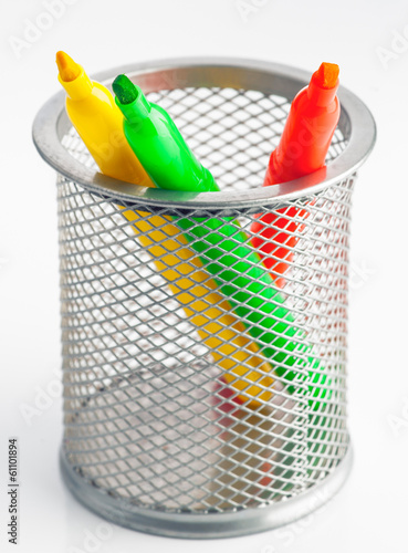 Green fluorescent yellow and orange markers within bucket