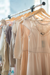 Dresses on a wooden hangers