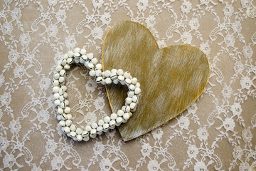 Wooden hearts on lace