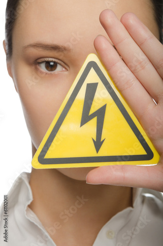 Woman holding a lightning bolt symbol
