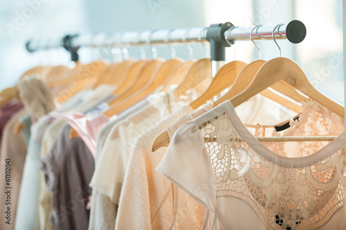 Dresses on a wooden hangers - 61102041