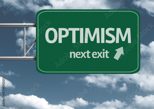 Optimism, next exit creative road sign and clouds