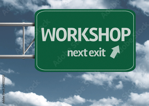 Workshop, next exit creative road sign and clouds