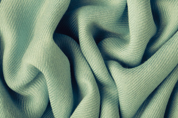 Gray background abstract cloth wavy folds of textile texture