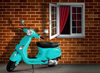 Scooter with Brick Wall Background