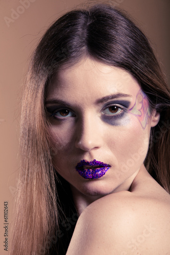 Portrait of girl with long straight hair and creative makeup