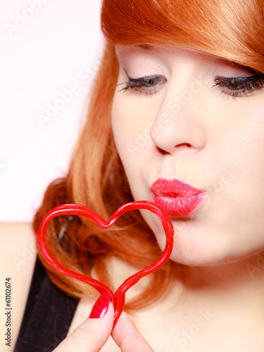 Girl holding red heart love blowing kiss. Valentines day.
