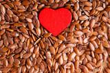 Fototapeta Ziarna lnu i czerwone serce
