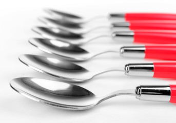 Silver spoons isolated on white