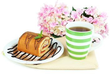 Cup of tea and sweets isolated on white