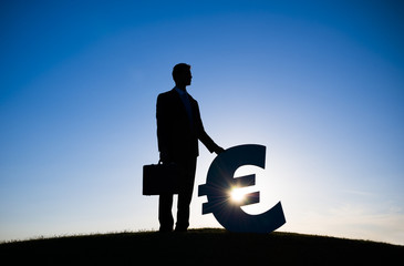 silhouette of Businessman Holding Euro Currency