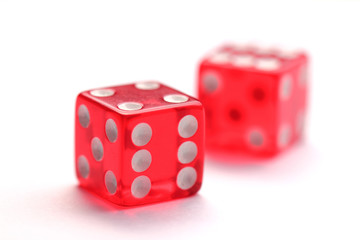 Red transparent dice isolated on white background